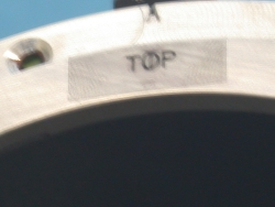 Align top of adapter with center of headlamp bucket tab.